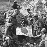 US Marines Capture Japanese Flag on top of a Pillbox at Iwo Jima