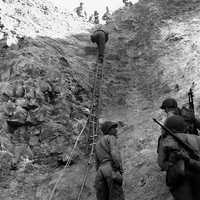 U.S. Rangers scaling the wall at Pointe du Hoc , Normandy, World War II