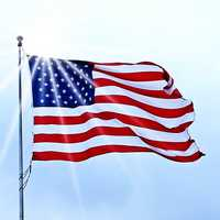 USA Flag fluttering under the sun in the wind