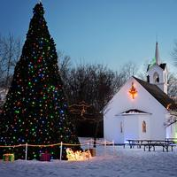 Lights and decorations and tree and church at Christmas