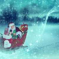 Santa Claus and Elf riding in the Sleigh