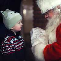 Santa talking with a young child