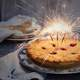 Birthday Pie with three sparklers as Candles