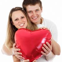 Couple holding heart balloon on Valentine's day