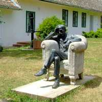 Babits Memorial House with man sitting in chair in Szekszárd, Hungary