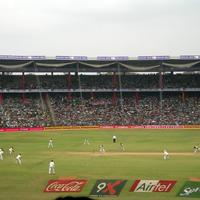 People playing cricket at M. Chinnaswamy Stadium in Bangalore, India