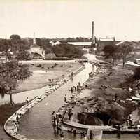 Mill with a canal connecting to Hussain Sagar lake in the 1880s in Hyderabad, India