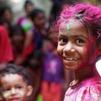 Child with paint on her in Mumbai, India