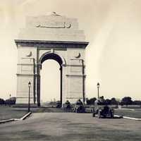 Armoured cars passing through India Gate in 1930s in Delhi