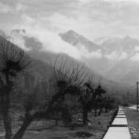 Black and White photo with path into the mountains with clouds in Srinagar, India