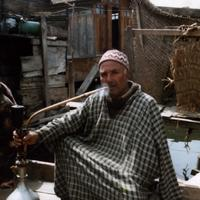Kashmiri man smoking a traditional hookah pipe in Srinagar, Kashmir, India