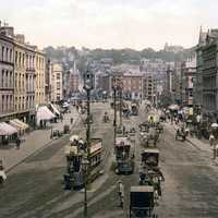 Patrick Street around 1900 with cars and people in Cork, Ireland
