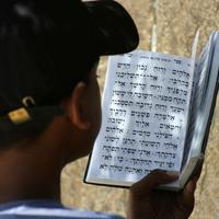 Reading a prayer book in Jerusalem, Israel