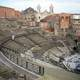 The Church of Saint Francis of Assisi backs the Cavea of the Greek-Roman Theatre in Catania, Italy