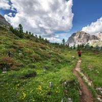 Hiker exploring the Dolomites landscape