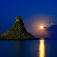 Moonlight over the Ocean and Island in Sicily, Italy