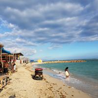 Beach and Shacks by the ocean under the skies in Kingston, Jamaica