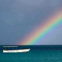 Rainbow over the ocean with a boat in Jamaica
