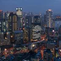 Osaka cityscape at night with skyscrapers