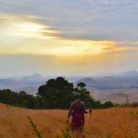 Tribesman looking at the landscape of Kenya