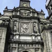 Main portal with view of clock at the Mexico City Cathedral