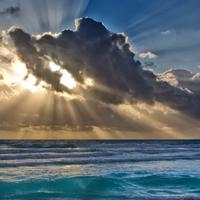 Sun Behind the clouds over the Sea in Cancun, Mexico