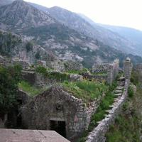 Stairs and mountainside stone buildings in Kotor, Montenegro