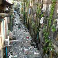 Dirty street back alley in Yangon Myanmar