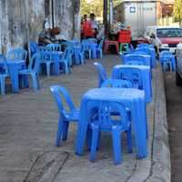 Teashop on Pavement with blue plastic tables