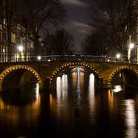 Bridge and Canals at Night, Amsterdam, Netherlands