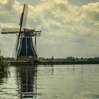 Windmill by the shoreline in the Netherlands