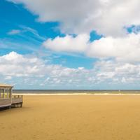Beautiful beach landscape under the sky and clouds in The Hague, Netherlands
