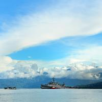 Sea and landscape off the coast in Papa New Guinea with US Transport ship