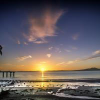 Sunrise on the beach in Auckland, New Zealand