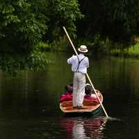 Boatman taking guests on a canoe