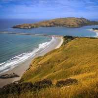 Entrance to Otago Harbour on the shore of New Zealand