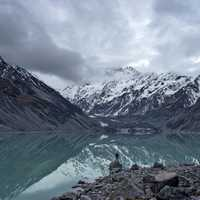 Hooker Lake landscape with clouds and fog with mountains in New Zealand