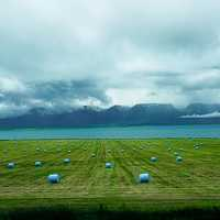 Bales of Hay under the clouds under the sky landscape