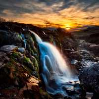 Beautiful Waterfall at Dusk with mossy rocks