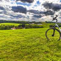 Bicycle and Background on grassy field under clouds