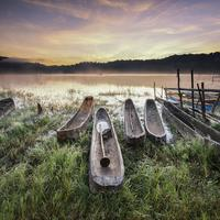 Canoes on the lake shore