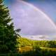 Double Rainbow over the Sky and Forest