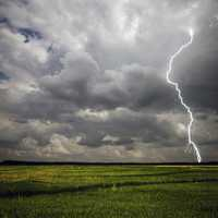 Lightning Strike on the farmland with stormy clouds