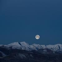Moon over the mountain landscape