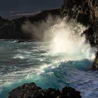 Ocean waves crashing on rocky shores