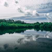 Pond and lake landscape with heavy clouds in the sky