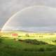 Rainbow Arcing over the Sky and Farms