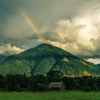 Rainbow behind the Mountain landscape