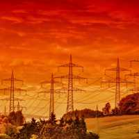 Red skies landscape with telephone lines