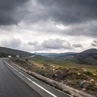 Road and landscape under clouds in the Andes